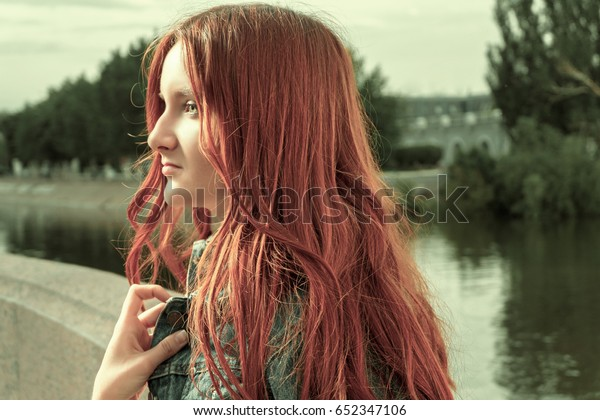 Ginger haired woman profile view, vintage color, old film style imitation