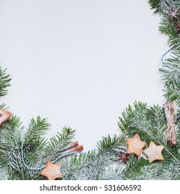 Ginger homemade cookies with strawberry jam on white wooden background with Christmas tree. fir tree. View with copy space. Flat lay, top view. Christmas Border - horizontal banner. Web size. stars.