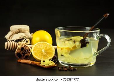 Ginger lemon honey and rosehip tea against influenza. Hot tea for colds. Home Pharmacy