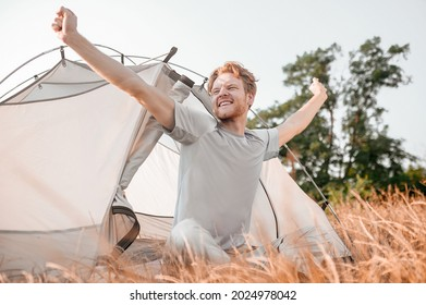 A ginger man feeling slepy and stretching - Shutterstock ID 2024978042
