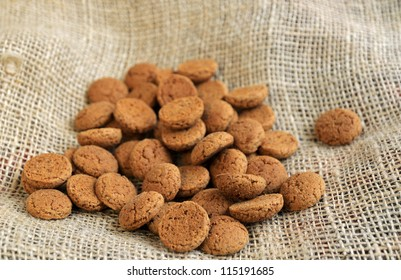 Ginger nuts or pepernoten, a traditional Dutch december sweet, on jute.