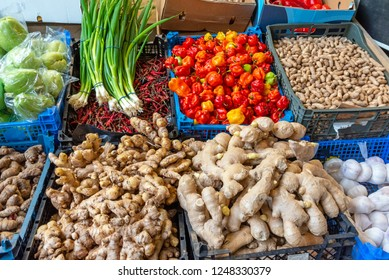 Ginger, pepper, peanuts and garlic for sale at a market in London