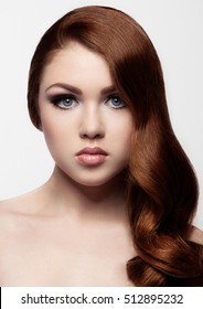 Ginger red long hair.Fashion girl portrait on white background