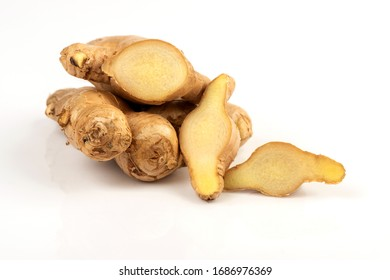 Ginger, rhizome and cut, laid on a white background.
