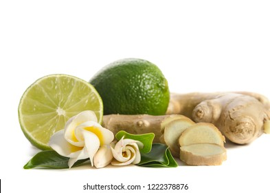 Ginger root and lime whole and half with flowers and leaves isolated on white background