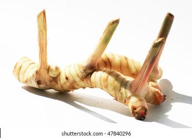 Ginger root on white.