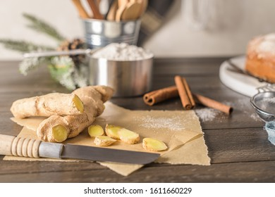 Ginger root and sliced on old kitchen countertop.