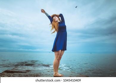 Ginger tatooed girl and sea