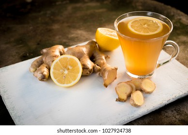 Ginger tea with lemon in a glass