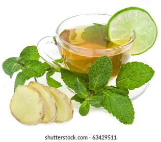 Ginger tea with lime and mint isolated over white background