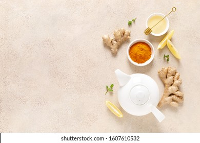 Ginger turmeric tea with honey, fresh lemon and mint