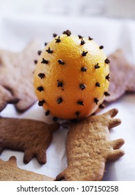 Gingerbread by an orange decorated with clove, Sweden.
