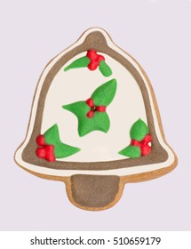 Gingerbread christmas bell decorated with white and green glaze