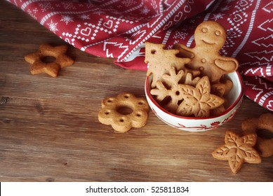 Gingerbread and christmas cookies in a bowl on wooden background with a place for text