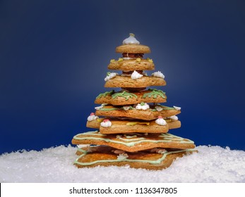 Gingerbread christmas tree over dark blue background