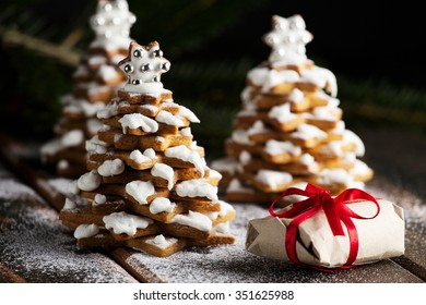 Gingerbread Christmas trees cookies with live christmas tree branch and decoration