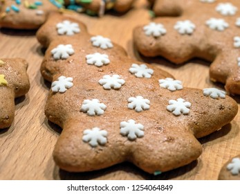 Gingerbread Christmas tree-shape cookie decorated with white stars