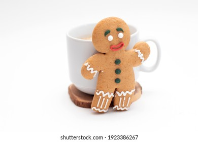 Gingerbread classic decorated cookie with cup of coffee.