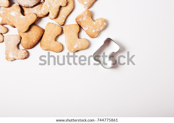 Gingerbread and cookie cutters background.Christmas shoe.Top view.Flat lay.