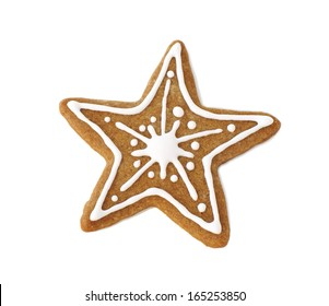 Gingerbread cookie in the form of a star, decorated for Christmas with icing