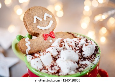 Gingerbread cookie man in a hot chocolate with marshmallow