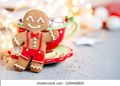 Gingerbread cookie man and hot chocolate with marshmallow
