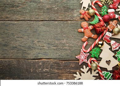 Gingerbread cookies with chrismas decorations on wooden table