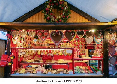 Gingerbread cookies at Christmas Market at Charlottenburg Palace in Winter Berlin, Germany. Advent Fair Decoration and Stalls with Crafts Items on the Bazaar.