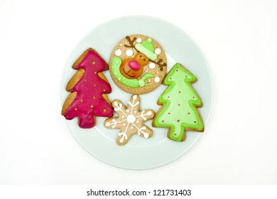 gingerbread cookies decorated with icing on a plate