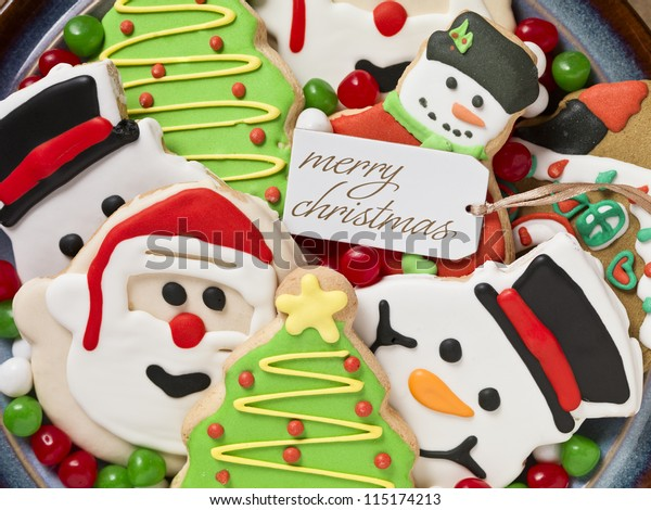 Gingerbread cookies decorations and colorful candies on a plate