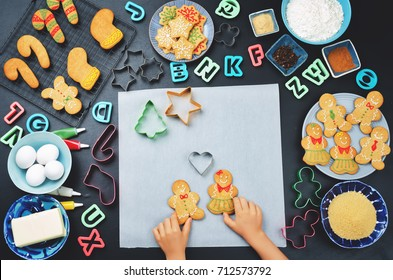 Gingerbread cookies with ingredients for baking and kids hands. toning. selective focus