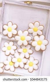 Gingerbread cookies in the shape of chamomile in wooden box with copyspace