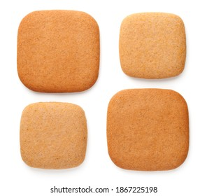 Gingerbread cookies in shape of squares in various size isolated on white background. Top view