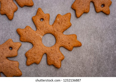 Gingerbread cookies in the shape of stars and leaves ready to hang on a Christmas tree as part of preparations for Christmas