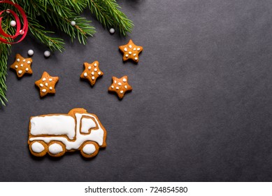 Gingerbread cookies truck shaped on black background, Christmas