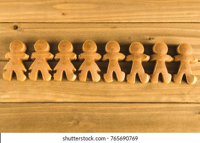 Gingerbread Girls and Boys Dough on Wooden Background