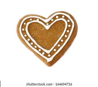 Gingerbread heart cookie decorated for Christmas on white background