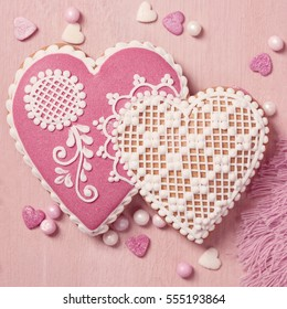 Gingerbread heart cookie on a pink background
