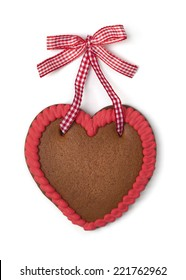 Gingerbread heart with copy space on a white background