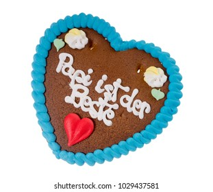 gingerbread heart with the german words Daddy is the best isolated over a white background
