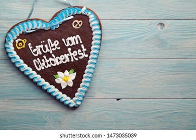 A gingerbread heart from the Oktoberfest on a wooden table