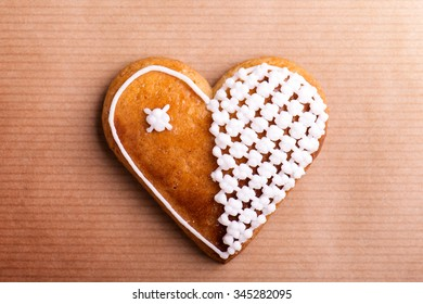 Gingerbread heart. Studio shot on paper background.