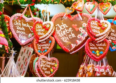 "Gingerbread Hearts at German Christmas Market. Nuremberg, Munich, Fulda xmas market in Germany.On traditional ginger bread cookies written ""I love you"" in German."