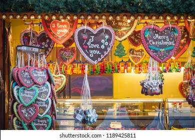 Gingerbread hearts on display at a confectionery stall of Christmas market winter wonderland in London