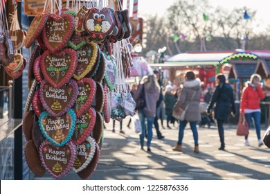 Gingerbread hearts on display at a confectionery stall of Christmas market in winter wonderland of London