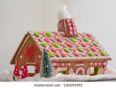 A gingerbread house with christmas decorations