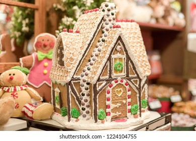 Gingerbread house decorated with candy and icing on display at candy store