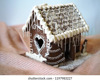 Gingerbread house with glaze, a heart shaped window, homemade