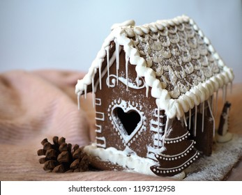 Gingerbread house with glaze, homemade, pine