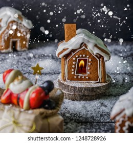 Gingerbread house on a festive Christmas snow background